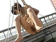 Mari Kamiya is bound and suspended in the air by her master