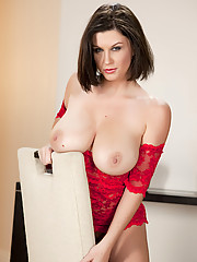 Sara Stone plays with her gigantic boobs and pussy on a chair
