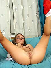 Check out this hot babe santa she gets naughty on the sofa and brags her fresh pinkish pussy