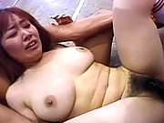 Asian soccer chick strokes pecker with boobs