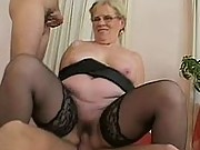 Chubby granny takes on two cocks