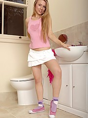 Horny teen cutie masturbating on the toilet