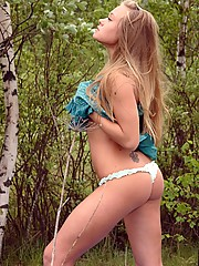 Daring teen chick masturbating in the forest