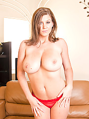 Sara Stone strips out of her lingerie and plays with her huge boobs