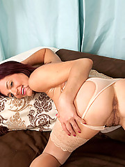 Horny redhead Sofia Matthews fucks her milf pussy with a silver vibe