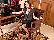 Hot secretary wearing glasses plays with her fuzzy pussy
