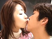 Eri Kikuchi kissing her young lover before licking his cock