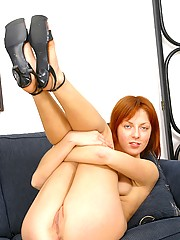 Very horny naked redhead playing with pussy