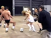 Topless asian girls playing a game of soccer