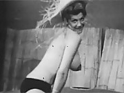 Horny vintage stripper wearing a straw hat