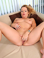 Horny mature Kelly Leigh dips her experienced fingers in her hot milf pussy