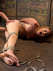 Payton Bell gets tied up, spanked, fist fucked, and put into crazy electrical predicament bondage
