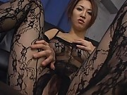 Yuki Touma looking very sexy in a black lace body stocking