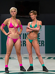 Smaller girl thoroughly dominates bigger girl in non-scripted wrestling.  Blond is made to submit to crushing leg scissors and head figure fours.