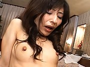 Ryoko playing with her wet pussy with a white vibrator