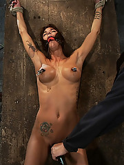 Gia DiMarco is bound and stripped, her nipples tortured.  A monstrous weight is hung from her neck, her shave cunt is tortured, she is left to suffer.