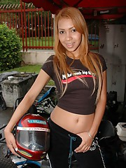 Tania Spice spend her day riding a go-kart and she finishes it with some juicy times in her bedroom
