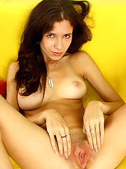 Topless hot babe Iraina shows off her fresh juicy tits and posing all the way on the sofa