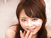 Japanese AV Model strokes his cock as she performs oral sex