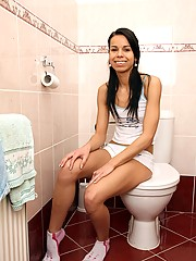 Teen girl has sexual pleasure on the toilet