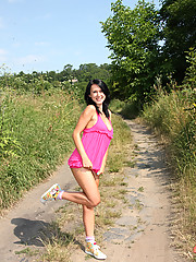 Chick loves masturbating outside on dirt road