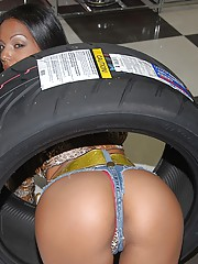 Check out this super sexy long leg latina get fucked inside a tire shoppe in these hot fucking pics