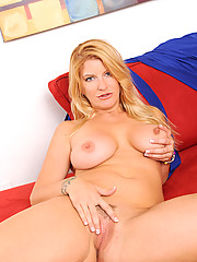 Busty Robbye Bentley pops out her massive tits and gets busy with her two toys on the sofa