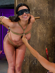 Busty brunette gets hung upside down tickled, shocked with electricity, and made to lick pussy in lesbian BDSM scene