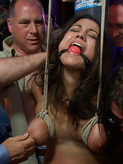 Big tittied brunette gets used as a party hole at a local bar. Bondage, sex, and BDSM in PUBLIC!