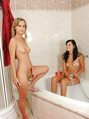 Two very horny lesbians taking a sexual bath