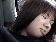 Asian girl masturbating her snatch in a car