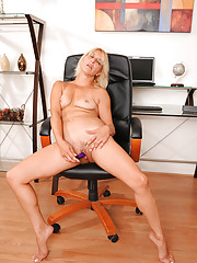 Horny secretary takes off her clothes and masturbates with a vibrator at the office