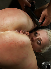Hot blond is abused by 4 DOMs. She is canned, flogged, pussy fucked, ass fucked, made to cum over and over, and squirted on!  This whore is abused.