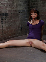 Little Lolita Haize has her clothes cut off, is bound with elbows together, spread legs and made to cum!  Brutal crotch rope pulls her off the floor!