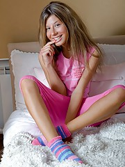 Chick inserting a large pink pleasure stick