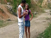 Daring teen couple having sex on a dirt road
