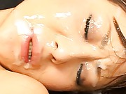 Naho Ozawa with tons of sperm on her face from a group of men