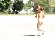 Amateur cutie runs around the track with no clothes on