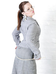 Business suited british dominatrix