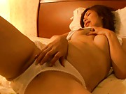 Unknown Model cute mature model playing with herself in bed