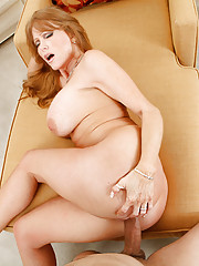 Darla really wants a painting for her collection and is turned on by all the artwork so she wants to make whoopie. This sexy red head starts off with some awesome head then goes wants to get fucked on the couch.  She loves to get rocked in her high heels