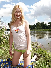 Naked horny teenager masturbates near a lake