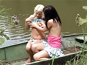 Two lesbian teenage girls playing on a boat