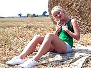 Girl enjoys sexual fondling in a large field