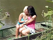 Two horny lesbian teenage chicks on the water