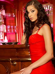 Evelyn Lory in a sexy red dress and heels