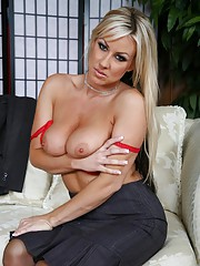 Carolyn Resse posing in black stockings and red lingerie