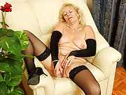Naughty granny uses a toy to satisfy her mature pussy