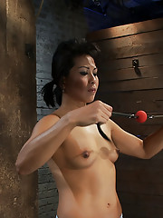 Hot Asian MILF with huge nipples is made to cum hard, elbows bound, nipples clamped & weighted, pulled to her tip toes with a brutal crotch rope,