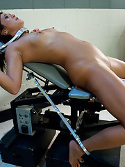 Sci-fi fantasy: pretty girl bound in foreign lab made to cum by machines, her pussy spread by a speculum showing her contracted, cum wet pussy walls.